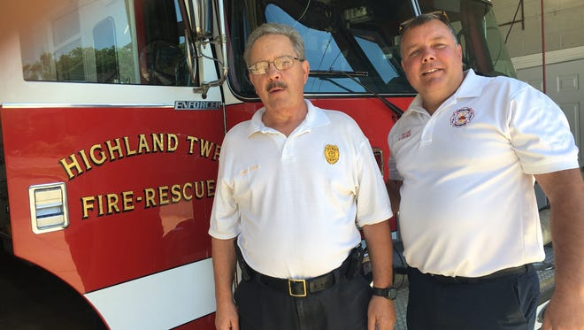 Highland Township Assistant Fire Chief Richard Cole (left) with Chief Ken Chapman.
