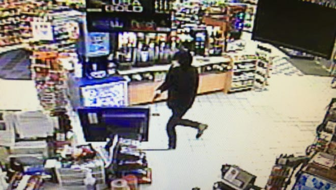 In this surveillance video image, an armed man is seen robbing the Speedway on Ohio 310 on May 13.