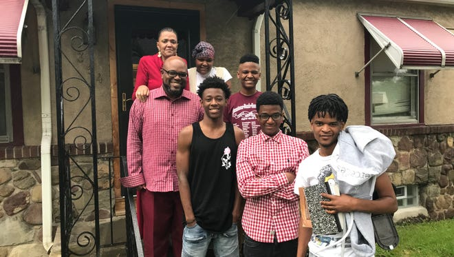 Ernest Flagler-Mitchell, left, with his wife Keia, daughter Ja'Mese, 14, family friend Brian McGriff, son Jairus, 12, son Ernest Jr., 16, and son Richard, 18.