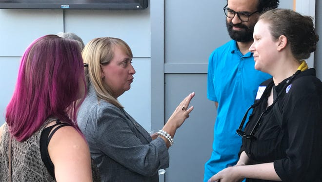 Mary Geren (in gray) chats with supports at election party in Clemson Tuesday.