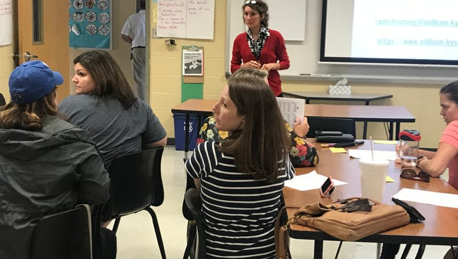Jamie Miller, Oldham County Schools ECS instructional coach, leads small group session with parents.