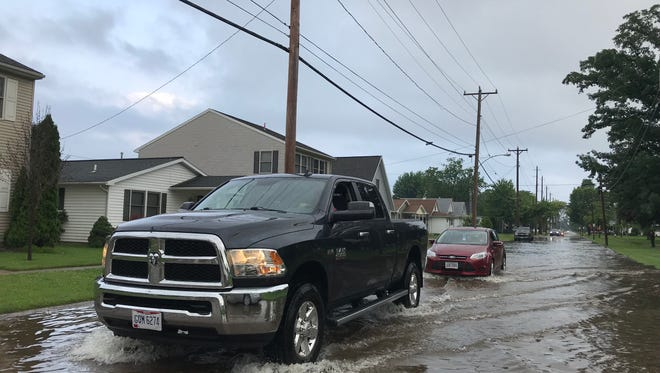 Heavy rainfall in June 2018 caused high water and flooding on dozens of Ottawa County roads, including East Second Street in Port Clinton.