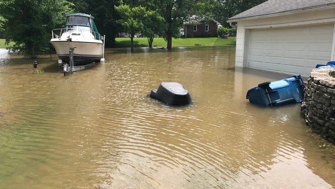 Extreme rains overnight flooded Todd Geyer's basement on Locus Street in Oak Harbor with four feet of water. Officials said from five to eight inches of rain drenched the area in less than 10 hours.
