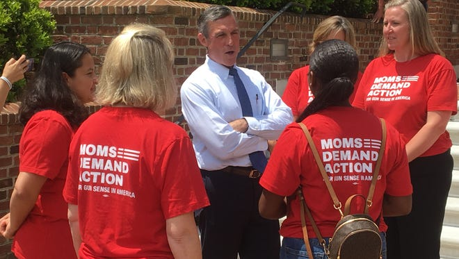 Gov. John Carney speak about gun control on Wednesday with members of the Delaware chapter of Moms Demand Action.