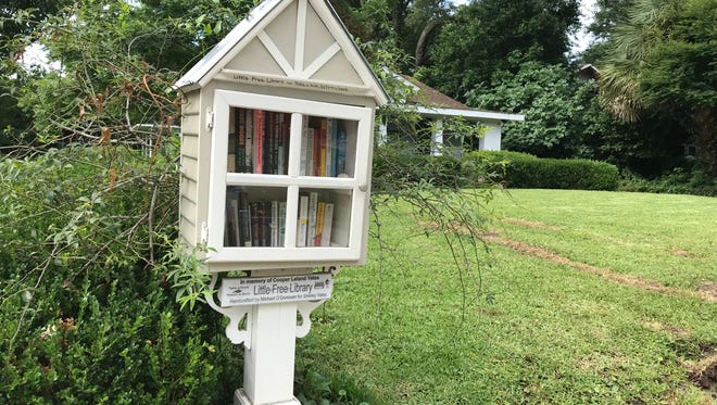 This Little Free Library in East Hill was made by Michael O'Donovan for Shelly Yates to honor her father, Cooper Yates who died in 2004.