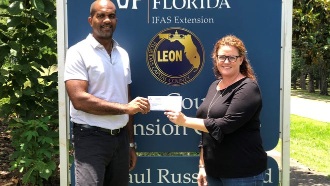 Leon County Farm Bureau President, Sharon Spratt, right, presented the check to Marcus Boston, Leon County Extension Director and Extension Agent on June 13.