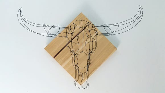 Alison Brynn Ross runs an Etsy shop selling wire taxidermy products. Amid fee changes, she plans to look for new platforms to sell.