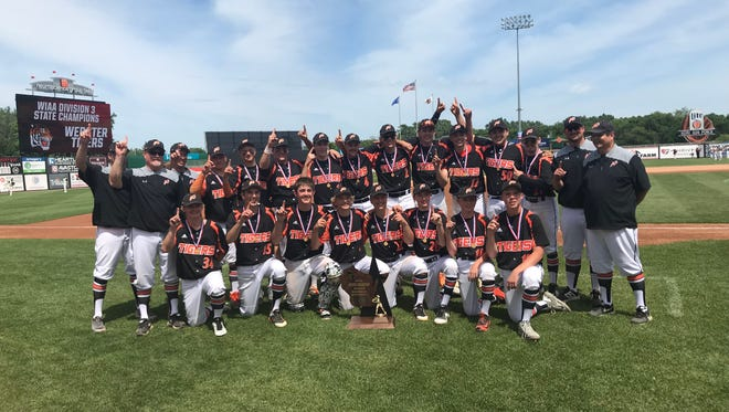 Members of the Webster baseball team pose for a team photo after winning the Division 3 state title Thursday at Fox Cities Stadium.