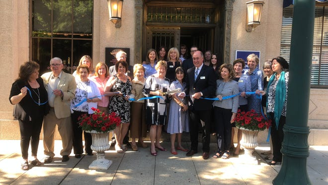 Summit Mayor Nora Radest cut the ribbon when Coldwell Banker Residential Brokerage reopened its newly renovated office and introduced its new manager, John Geaney.