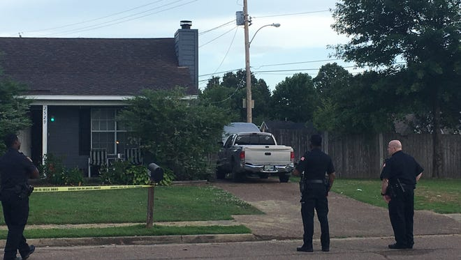 Memphis police stand outside the scene where two were shot on the 2500 block of Country Trail early Tuesday morning.