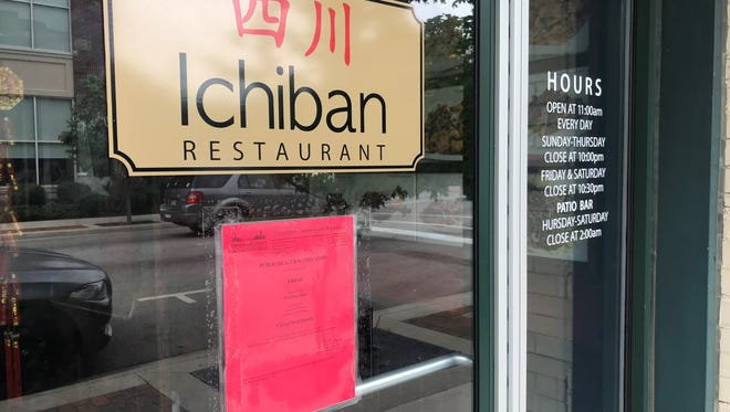 The red sign on Ichiban Restaurant's doors tells customers that it is closed. The Board of Health revoked Ichiban's food permit after repeated critical violations were unresolved.