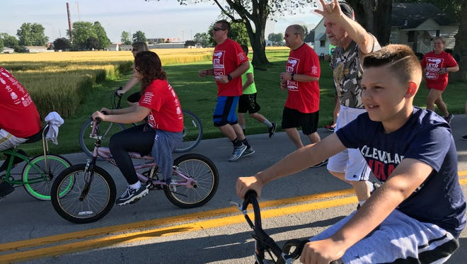 Community members run and bike through the streets of Fremont for the annual Special Olympic Torch Run.