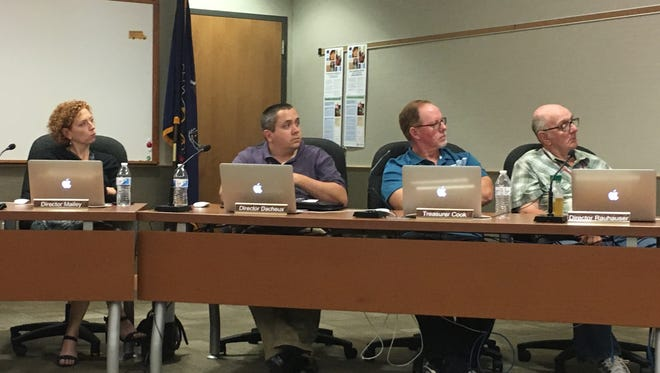 At a board meeting Tuesday, June 19, Dover Area School District board members studied bids for the high school land development project before approving them. (Pictured: Rachel Mailey, Dennis Dacheux, Jr., Steve Cook (treasurer), Charles Rauhauser)
