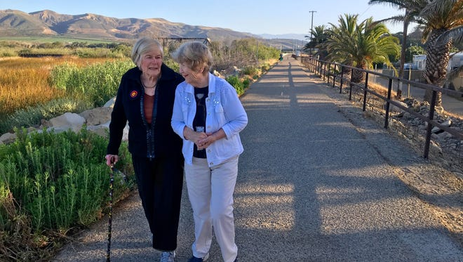 Shirley Shanahan, left, and her friend Annette Clark walk beside the lagoon on their morning beachside stroll in Ventura. They've done this two-mile walk together for more than 40 years.