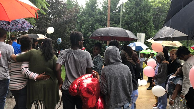 Family and friends gathered outside of a home in the unit block of Lloyd Street on Friday, June 22, to celebrate Doris Dorsey's life.