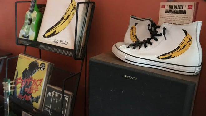 """Troy Moon's mini-shrine featuring Andy Warhol's """"Banana"""" on the cover of the album """"The Velvet Undeground & Nico,'' also reproduced on limited edition Converse"""