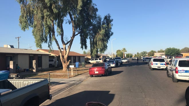 Photo of the scene where two are dead after South Phoenix shooting.
