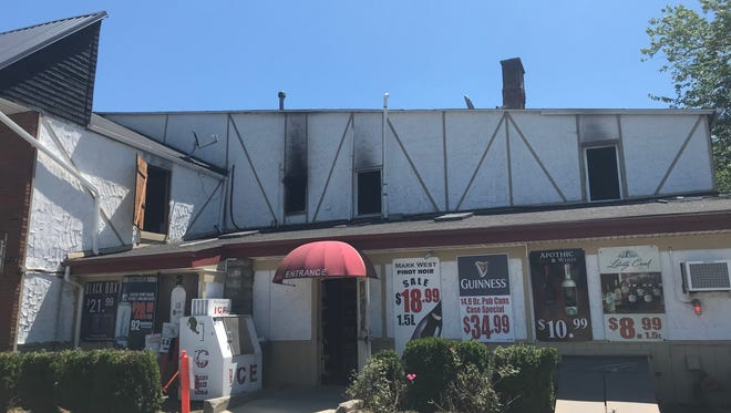 A fire broke out above a liquor store in West Milford, seriously injuring the woman who lived in the apartment.