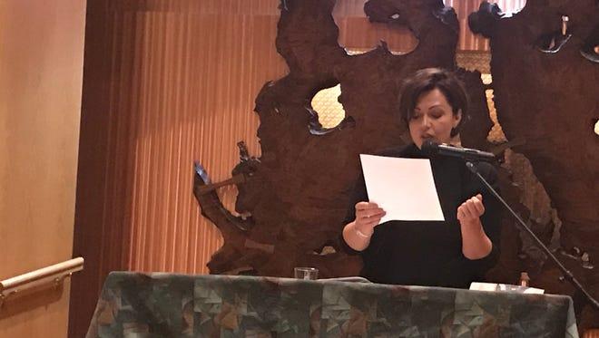 "Montclair resident Dagmara Dominczyk reads during the ""Borders of the Heart"" event at Bnai Keshet in Montclair on June 27."
