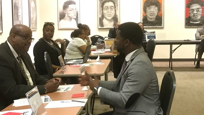 Principals in the Detroit Public Schools Community District interview candidates for art and music teaching jobs during a recruiting fair Wednesday, June 27, at the Charles H. Wright Museum of African American History.