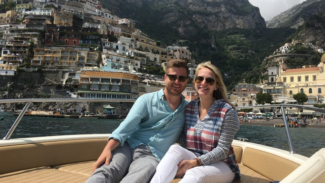The Courier Journal's Jeff Greer and his wife, Elizabeth, take in beautiful Positano, Italy, from a boat.