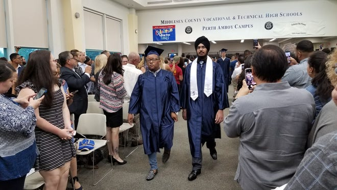 Class of 2018 graduates enter the room on the Perth Amboy Campus of the Middlesex County Vocational and Technical Schools during their commencement exercises on June 27.