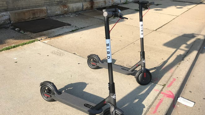 Bird scooters are parked in the Walker's Point area of Milwaukee.