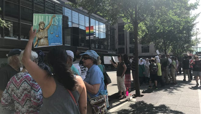 Rally against Trump's travel ban at Fountain Square on June 29.