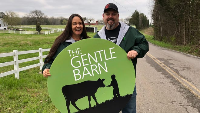 Ellie Laks and Jay Weiner, co-founders of The Gentle Barn animal sanctuary, stand in front of the property they are purchasing in Rutherford County. The Gentle Barn Nashville will open Aug. 26, 2018.