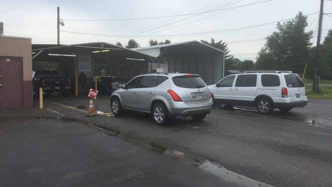 Motorists wait in line in Smyrna Thursday June 28, 2018, to take emission test required to renew vehicle registration. A new state law seeks to allow for an end of emission testing, but Tennessee Department of Environment and Conservation officials expects the process to take at least three years before the U.S. Environmental Protection Agency agrees.