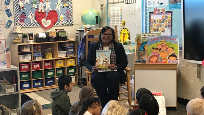 "Plymouth-Canton Superintendent Monica Merritt, here reading to students, was rated ""highly effective"" by her bosses on the district's board of education."
