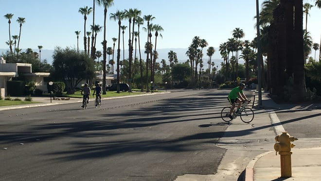 Bicyclists are seen on Laverne Way in Palm Springs. It's among several roads getting new bike lanes this summer, but it will undergo a road diet.