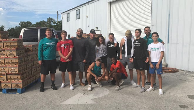 The Gulf Coast High School football team recently donated their time and manpower to Harvest Collier, a local nonprofit organization dedicated to feeding the less fortunate in Collier County.