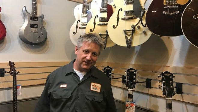 Joe Leach, the owner of Riff City Guitar & Music Company poses for a portrait. Riff City opened Thursday in the old Sioux Falls Music space on 41st Street.