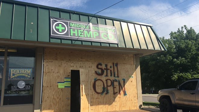 Tennessee Hemp Company on West Clark is still open and operational behind a boarded up front after someone drove a car through their front windows during a burglary.