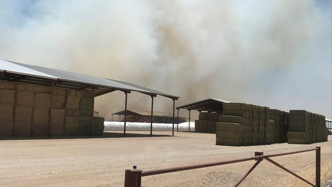 Nearly 120 firefighters responded to a large hay fire Friday morning in Buckeye.