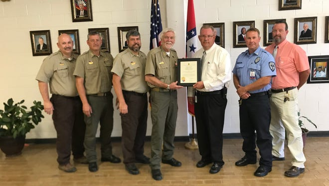 """Arkansas State Parks recently recognized the Regional Maintenance Program at the Department of Corrections North Central Unit at Calico Rock. A Directors Commendation was presented to the North Central Unit as """"a valuable partner in the beautification and maintenance of Ozark Folk Center State Park and Bull Shoals/White River State Park."""" The Regional Maintenance Crew .spent more than 4,000 man-hours at the two parks in the last year alone. Pictured (left to right) are Arkansas State Parks Assistant Superintendents Ed Thomas and Stewert Taylor; Superintendents John Morrow and Billy Lindsey; Arkansas Dept. of Corrections Warden Stephen Williams, Captain Lyndal Cooper; and Deputy Warden Christopher Johnson."""