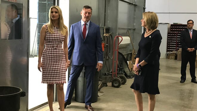 Ivanka Trump and Congresswoman Claudia Tenney are given a tour of Suit-Kote by owner Frank Suits