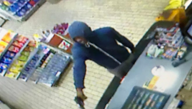 Police are searching for three men they say robbed the Newport 7-Eleven early Monday morning.