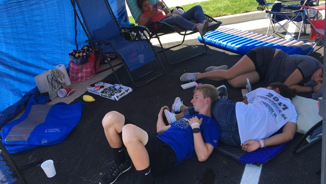 Jordan Jones (in lounge chair) and her friends camp out at the new Staunton Chick-fil-A in order to receive 52 #1 meals on Tuesday, July 10, 2018.