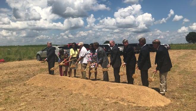 Ground is officially broken on the Special Agent De'Greaun ReShun Frazier TBI Crime Laboratory and Regional Headquarters in Jackson on Tuesday. Fraziers wife and children - Shannon, Kamaryn and Kendrix - Tennessee Governor Bill Haslam, State Senator Ed Jackson, TBI Director David Rausch and Madison County Sheriff John Mehr were among those breaking ground.
