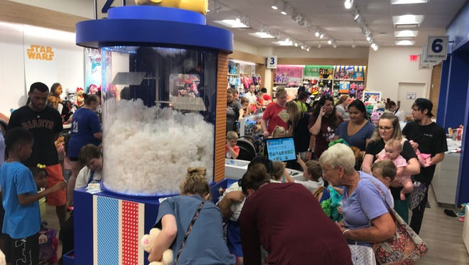 Customers crowd the Build-a-Bear location at the Empire Mall on Thursday for the chain's Pay Your Age promotion.