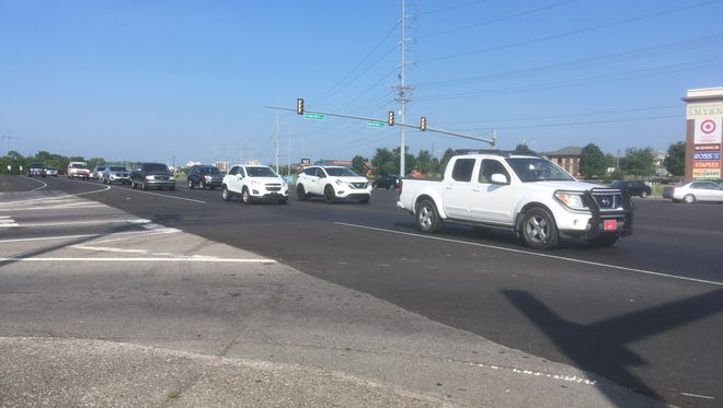 Drivers on Sam Ridley Parkway cross the StoneCrest Parkway-Industrial Boulevard intersection Thursday July 12, 2018.