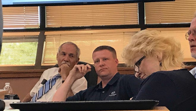 County Commissioner John Henry asks pointed questions about the Eddy County Public Works Department's request for additional personnel at the July 17 meeting in Carlsbad.