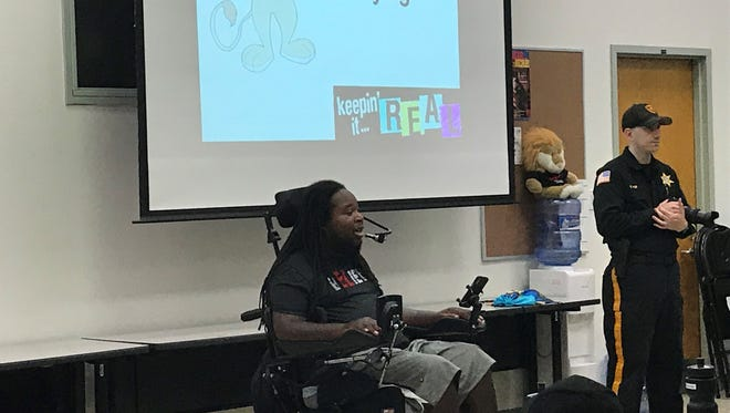 Eric LeGrand addressing the cadets at the DARE program/junior police academy.