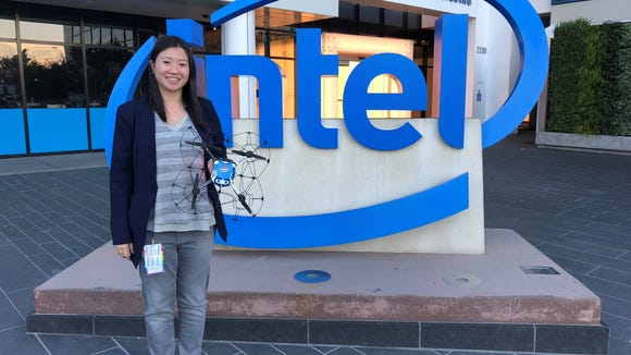 """Natalie Cheung, general manager of Drone Light Shows at Intel, poses with one of the """"Shooting Star Drones,"""" built specifically for drone light shows."""
