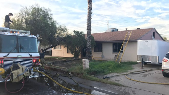 Fire officials found a badly burned, deceased body inside a Phoenix house fire.