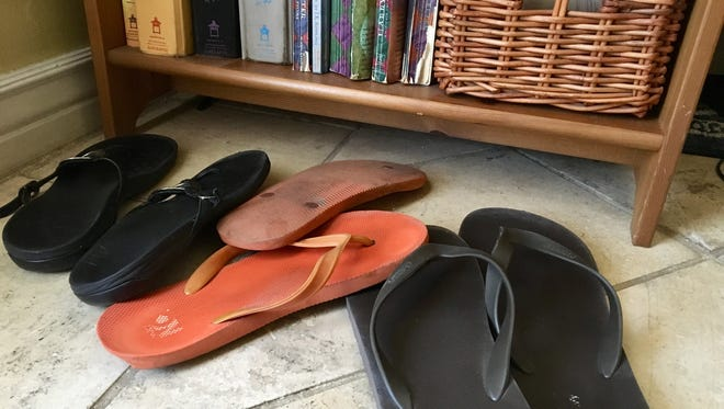 Keep flip flops or shoes you can slip into easily by the front and back doors to protect your feet from sizzling sidewalks and hot asphalt.