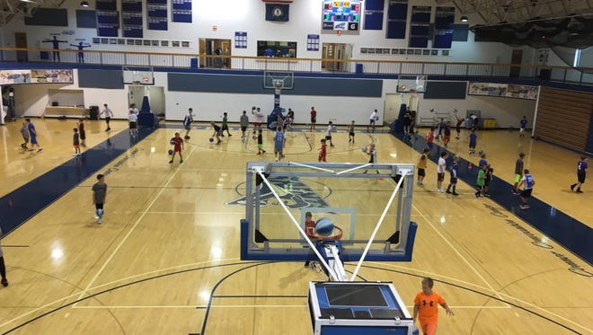 Youth basketball campers enjoy the sport at the Connor Convocation Center July 24.