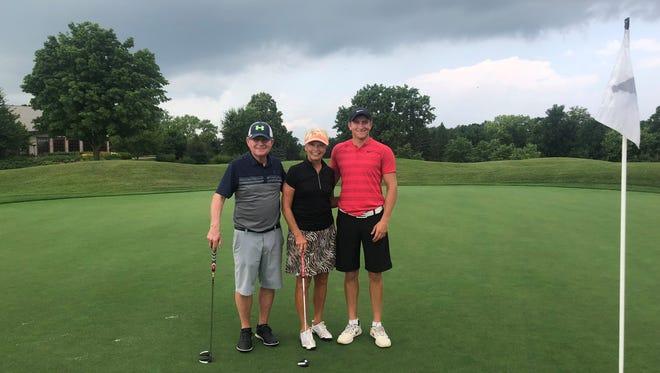 John Lieser, Barb Hanson and Jacques Wilson at Hazeltine National Golf Club in Chaska.